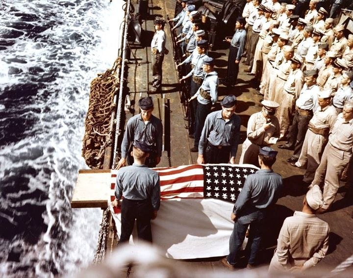 Burial at sea for a casualty of the battle for Iwo Jima aboard troop transport USS Hansford while she was evacuating wounded men to Saipan 25-28 February 1945.