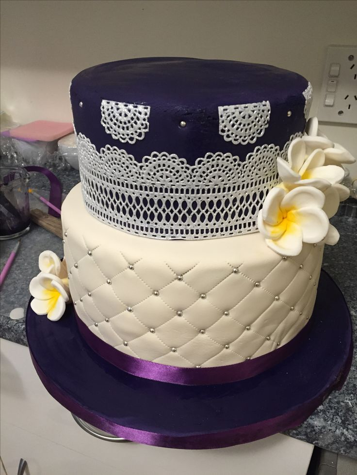 bottom tier chocolate cake 3 layer with buttercream, covered with ivory vanilla fondant, 2nd tier 3 layer carrot cake with cheese cream frosting covered with purple vanilla fondant and silver veil lace. 29 Oct wedding cake