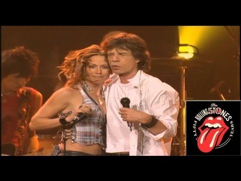 The Rolling Stones performing 'Honky Tonk Women', live at Madison Square Garden with Sheryl Crow. The performance took place in January 2003 on the Licks World Tour, celebrating the band's 40th anniversary.    This version features Mick Jagger on vocals, Keith Richards on guitar, Charlie Watts on drums, Ronnie Wood on guitar, Darryl Jones on bass,...