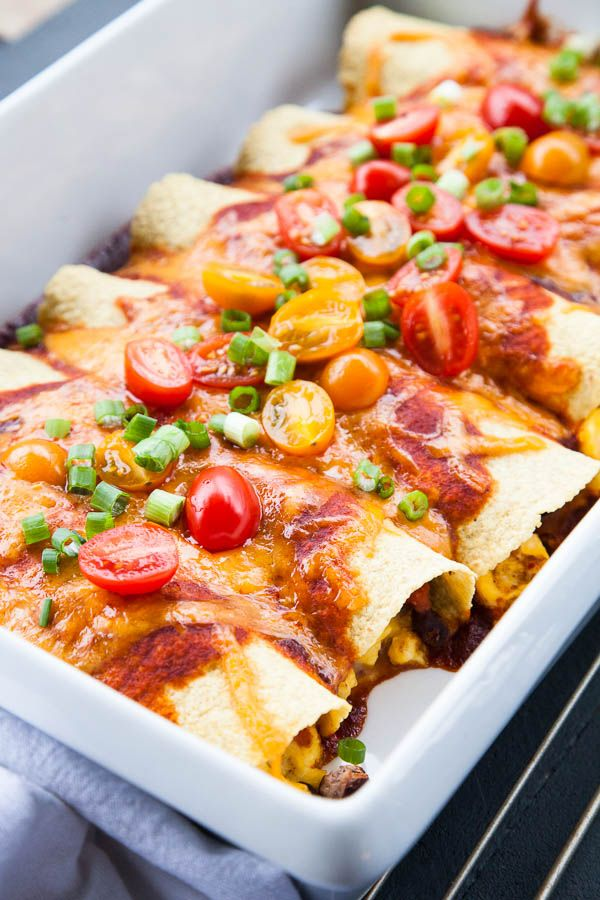 Black Bean Breakfast Enchiladas - Black beans, cumin-spiced tomatoes, and fluffy scrambled eggs are wrapped in soft tortillas, and then doused in a tomato red enchilada sauce.