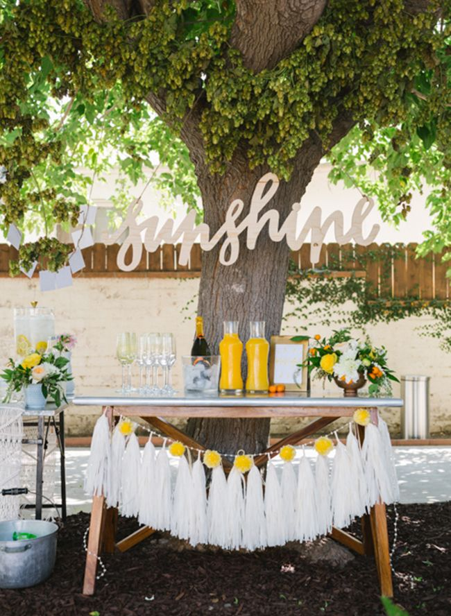 Yellow Sunshine Birthday Party with tassel and wooden decor