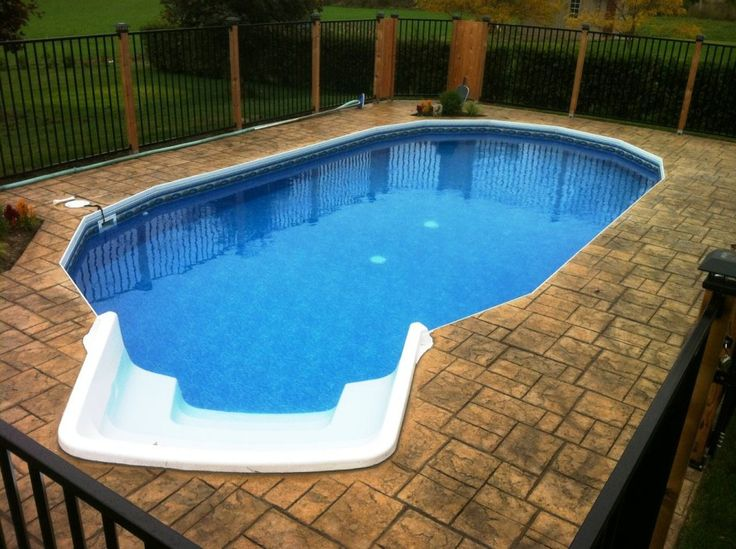 Above ground pool patios momentous above ground oval swimming pool decks with solar post cap for Small above ground swimming pool decks