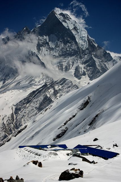 Annapurna Base Camp under the peak of Macchapucchre, Nepal (by nathan.c.potter).