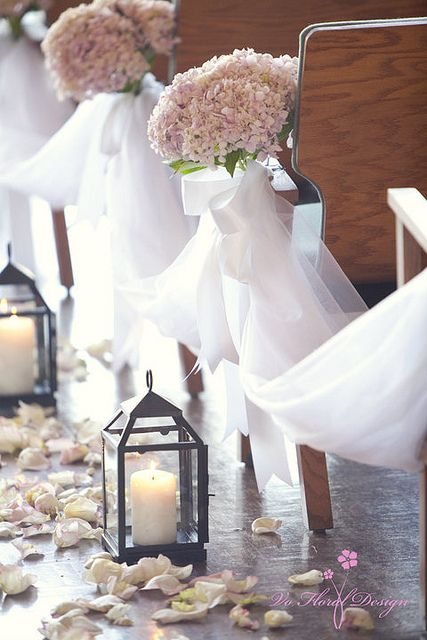 aisle lanterns, perhaps without the rose petals