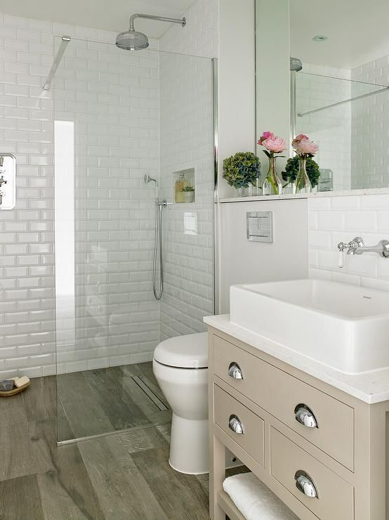 fantastic bathroom features a gray washstand painted farrow ball elephants breath accented with nickel cup beveled subway tilesubway - Bathroom Subway Tile Backsplash