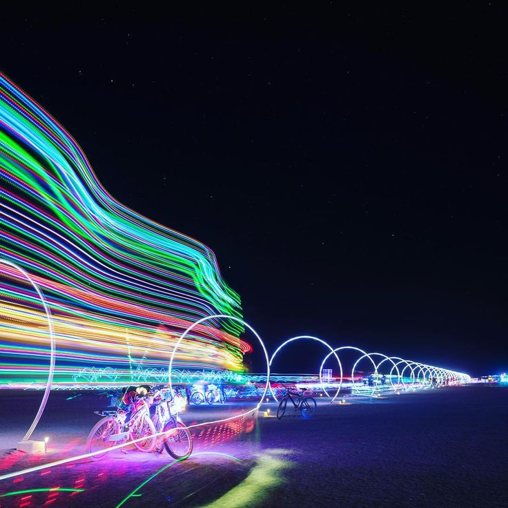 The Sonic Boom tunnel of light at Burning Man was awesome, but trying to impose a sense of motion was difficult to photograph. Luckily I got a biker that entered the frame that created a streak which produced the sense of motion I was looking for...#burningman #burningman2016 #blackrockcity #brc #playa