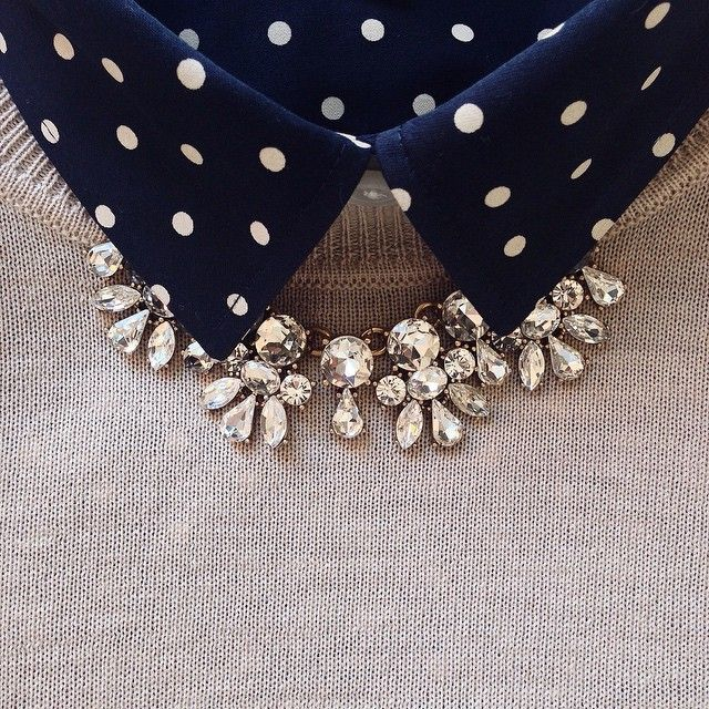 Navy polka dot shirt under camel merino wool sweater and J.Crew clear crystal statement necklace