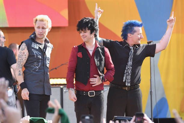 Musicians Mike Dint, Billie Joe Armstrong and Tre Cool perform on ABC's 'Good Morning America' at Rumsey Field in Central Park on May 19, 2017 in New York City.