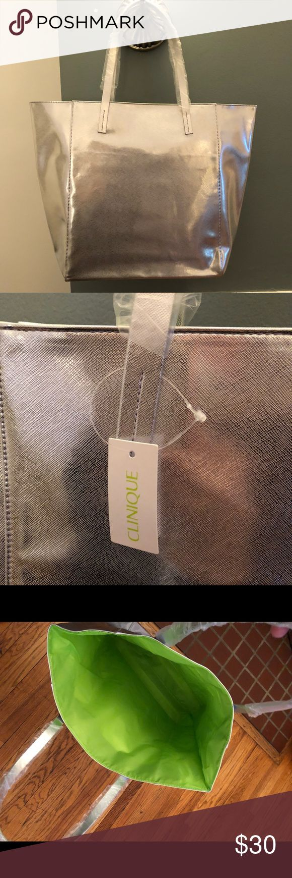 Large Silver Tote Large Silver Tote bag by Clinique. Lime green lining inside the bag - NWT. Clinique Bags Totes
