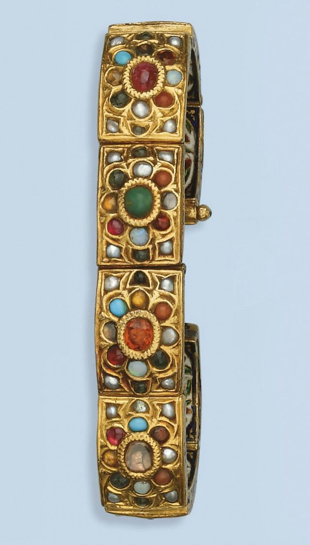 India | An enamel and gem set Navratna bracelet; Composed of eight gem-set panels representing planets of the Hindu astrological system, each depicting a polychrome enamel bird at the reverse | Early 20th century | 2,000€ ~ sold March 2010
