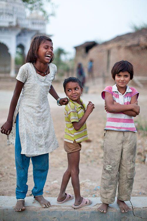 Selojenah, Shiram and Ameni laugh near their village's freshwater well. (photo: Mo Scarpelli): Photo