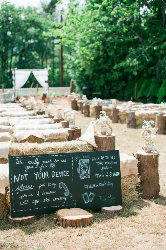 True country fishing themed Tillamook Oregon wedding with paper flowers, hay bale seating, tree stump aisle