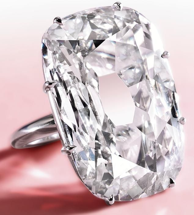 An Exceptionally Rare Diamond Ring.   The old mine cushion-shaped diamond weighing 33.03 carats, mounted in platinum, size 6. Sotheby's.