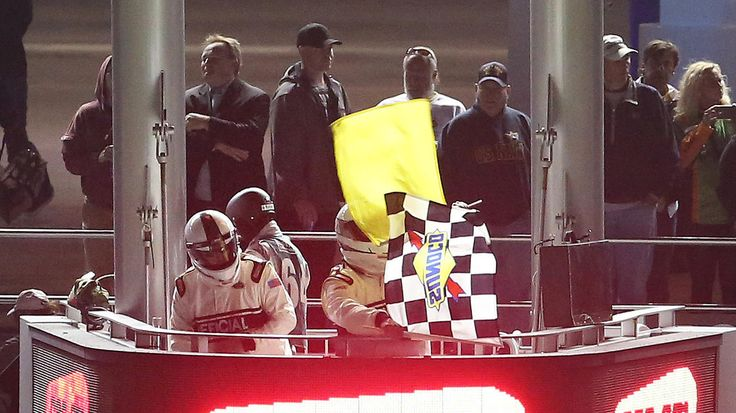 DAYTONA 500 QUALIFYING:    The checkered and caution flags are waved simultaneously as Kyle Busch crosses the finish line to win the second of the twin qualifying races for the Daytona 500, at Daytona International Speedway, in Daytona Beach, Fla., Thursday night, February 18, 2016. A crash in the back of the pack on the last lap of the race caused the caution. (Joe Burbank/Orlando Sentinel