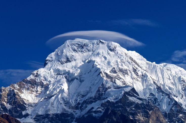 Lenticular cloud sitting above the Annapurna mountain ...