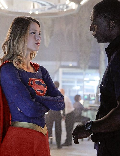 "Supergirl: ""So, did I pass?"" Hank: ""I see you share your cousin's appetite for wanton destruction, Miss Danvers."" Supergirl: ""You know, I am starting to answer to Supergirl."""