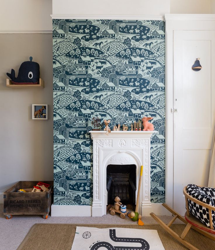 In Ted's room, the fireplace surround is papered in Farrow & Ball's Gable pattern. The jute rug is from Ikea and the monochromatic road-scene rug is Oyoy.