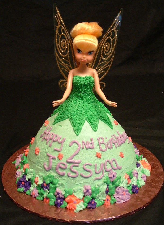 http://www.carolynssweettooth.com/images/Tinker%20bell%20Doll%20Cake%2007_25_10.jpg