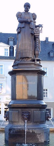 Barbara Uttmann (~1514-1575) monument in Annaberg Buchholz, Germany, by the Dresden sculptor, Professor Eduard Robert Henze. First raised in 1885, melted down for armaments in WWII, new casting erected in 2002 after a large fund raising project. There is another monument to her in Elterlein, Germany. She was the daughter of Heinrich von Elterlein.