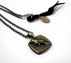 Brass Sparrow pendant on oxidized silver chain
