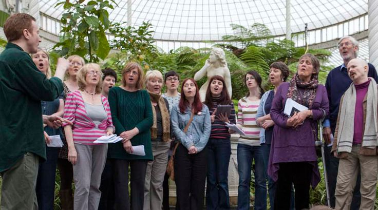 The West End Community Choir help launch Voluntary Arts Week 2013 at the Glasgow Botanic Gardens.