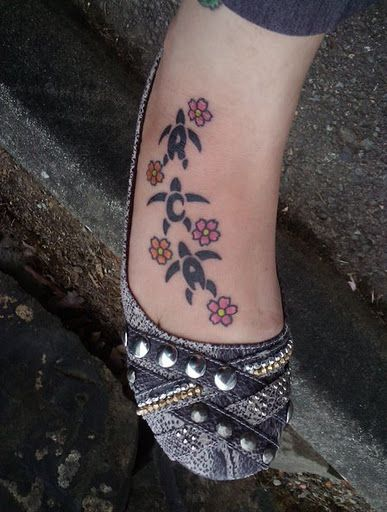 My Hawaiian Turtles tattoo...The body of each turtle are actually letters...my 3 sons initials ♥ R C A ♥