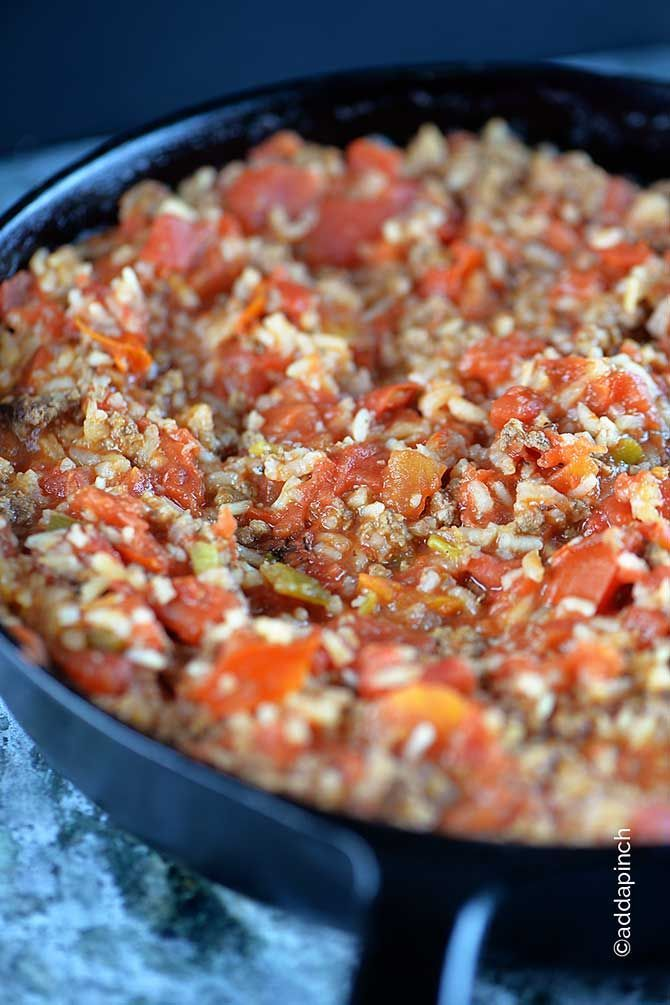 Spanish Rice with Ground Beef Recipe - One of my Mama's recipes that has been a family favorite for years! So simple to make and so scrumptious, you will love this one! With beef added to this dish, it becomes the main attraction for supper! // addapinch.com