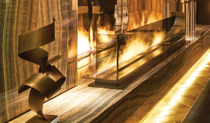 "<p>The lobby centrepiece in New York's Paramount Hotel, which is located in the theatre district, could be described as ""dramatic"" courtesy of three EcoSmart XL Burners and polished steel sheets.</p>"