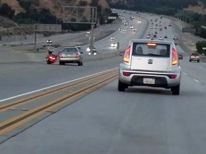 Video: Road Rage In The U.S.A — Biker's Kick Causes Two Cars To Crash