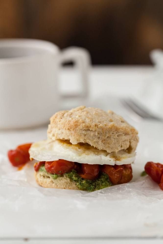 Egg, Roasted Tomato, and Pesto Biscuit Sandwich - yum! Want to make with GreatGrandma's bisquit recipe