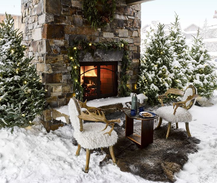 Outdoor fireplace decked out for Christmas