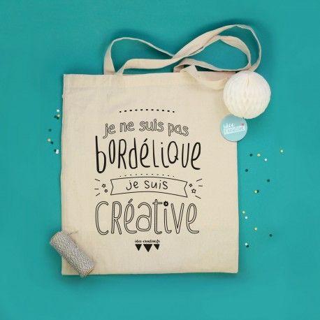 """Le tote bag idéal pour toute créative au bazar organisé qui voudrait faire passer le message : """"Je ne suis pas bordélique, je suis créative""""   Sac 100% coton de couleur naturelle en production équitable imprimé localement et sérigraphié à la main"""