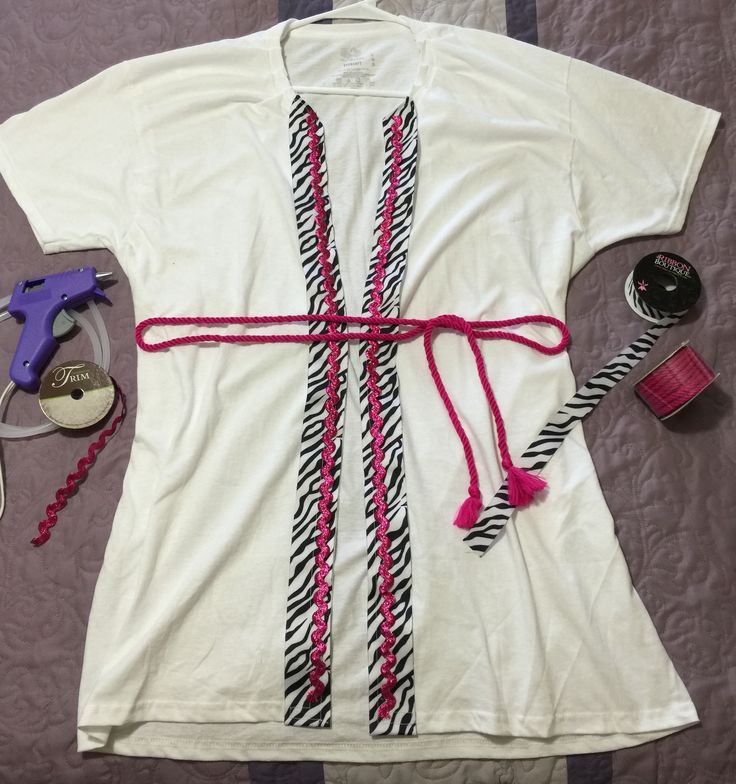 """I made there tee shirt """"Robes"""" for my daughter's Spa Birthday Party!  Cut a large white tee up the front. Fold each edge and stitch ribbon trim.  Let the girls choose their accent color and hot glue it to ribbon. Finish with matching rope tie for waistline. The girls loved it!"""