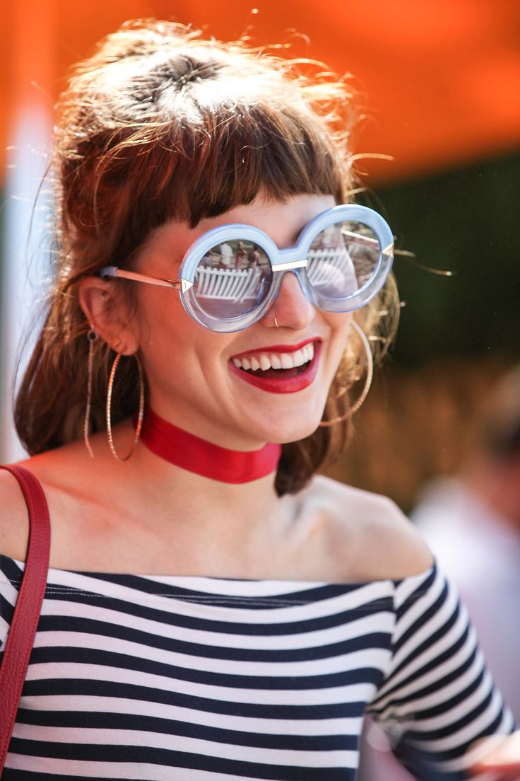 Langley Fox hits a perfect accessories balance with her red choker, hoop earrings and oversized round sunglasses – the secret to this success lies in the off-the-shoulder Bardot top