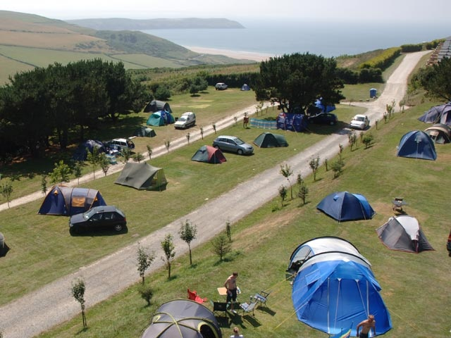 What a spot for a surfing break! Camping pitches at Woolacombe Bay