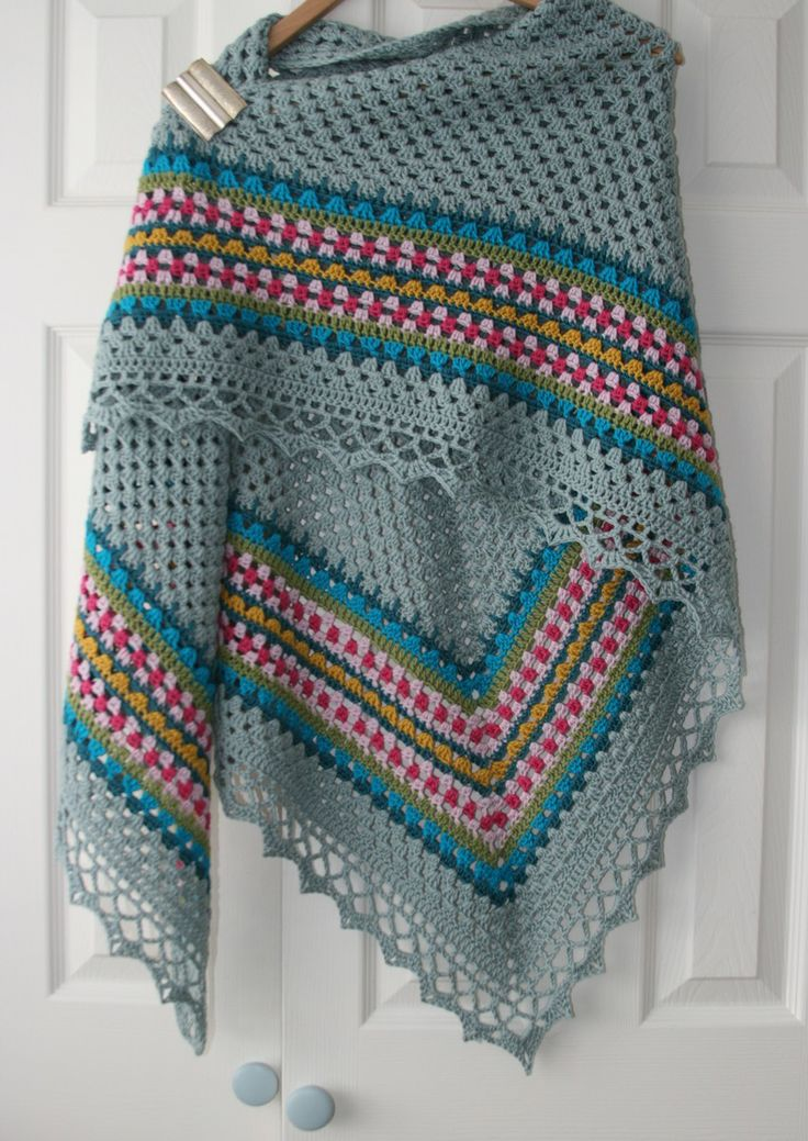 Lazy Daisy - Nordic shawl  I have a scarf that uses all the nordic pattern colors in this shawl. I would love to make this with an icy blue or pale teal background.