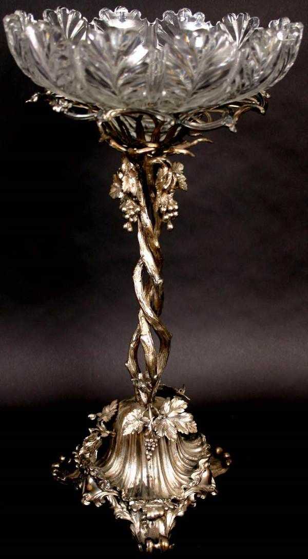 Tall Victorian silverplate epergne with grapevine motif.