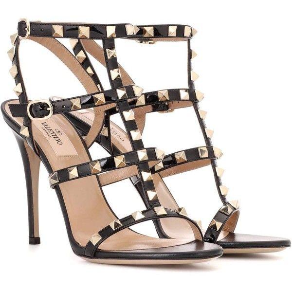Valentino Garavani Rockstud black patent leather sandals by Valentino.