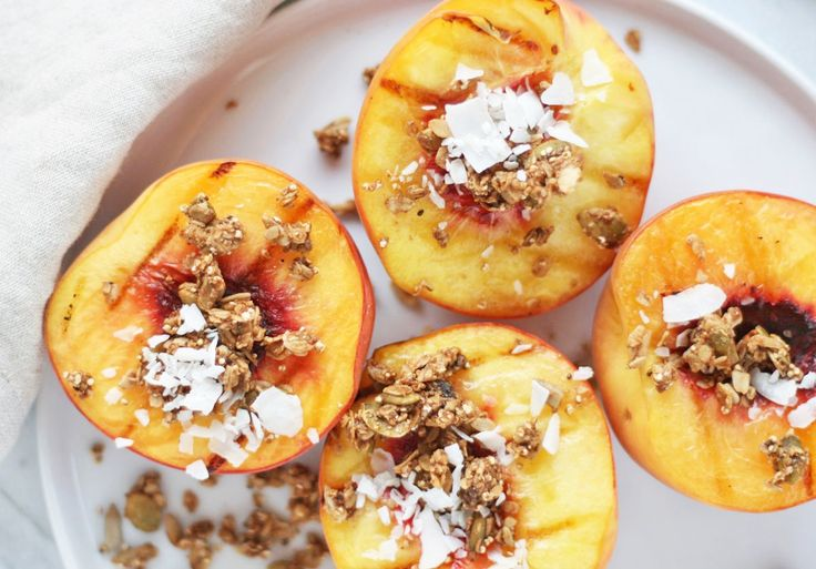 The easiest (and healthiest) BBQ dessert ever: grilled peaches stuffed with granola and served alongside vanilla ice cream.