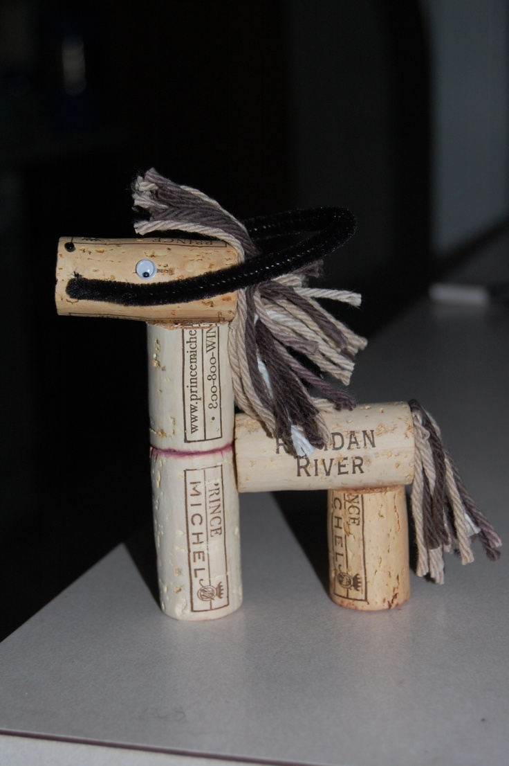 1st wine cork horse I made. 5 corks, 1 pipe cleaner for reins, 2 google eyes, 2 beads for nostrils & whatever color yarn for mane & tail.