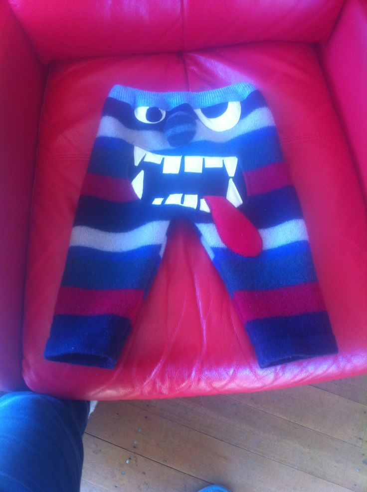 Monster bum pants made from recycled wool jumper someone has nicely shrunk in the wash so it has a felted quality to it. Appliqué on the face and your little one is ready to go.