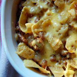FRITO PIE CASSEROLE 1 bag Frito's 1 can Ro-Tel 1/2 lb. Velveeta cheese 1 med. onion, chopped 1 tsp. salt 1 lb. ground beef Brown beef, onion and salt. Then layer meat, Frito's, Ro-Tel and cheese in baking dish. Bake 30 minutes at 350 degrees or until cheese melts through mixture