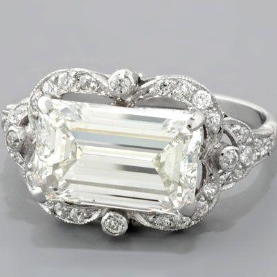 Emerald-cut Art Deco-style engagement ring. Beautiful!