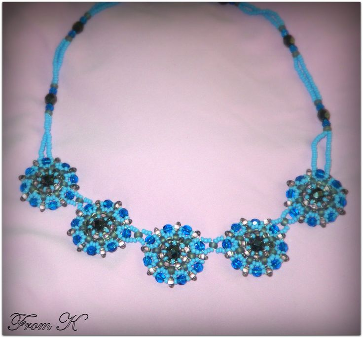 """""""Bib"""" style necklace designed to decorate much of the upper chest area. Sophisticated enough for formal occasions and fun enough for casual time. 40 cm long (sits on the base of the neck). Czech seed beads and special """"twin"""" beads are used here For more, visit my facebook page https://www.facebook.com/media/set/?set=a.255899171103055.81635.246629745363331&type=3"""
