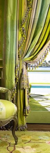 Absolutely gorgeous green draperies with fringe and tie backs.