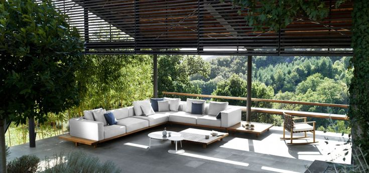 Tribù's Vis à vis sofa, is an exclusive outdoor sofa in teak with weather-resistant cushions