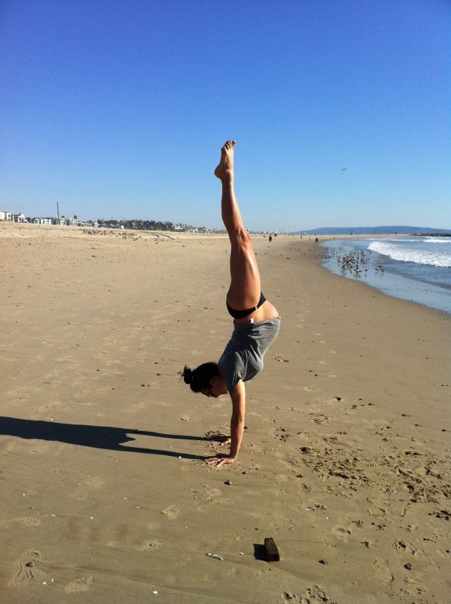 Wow! Handstand on the beach while pregnant.