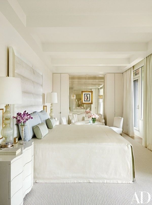 Vintage Seguso lamps from Lobel Modern flank the master suite's bed | archdigest.com