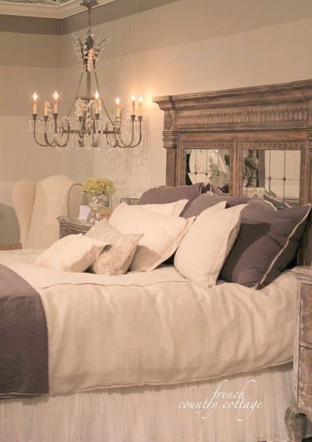 FRENCH COUNTRY COTTAGE: High Point Market -peeks how I love that big headboard with mirrors and that chandelier