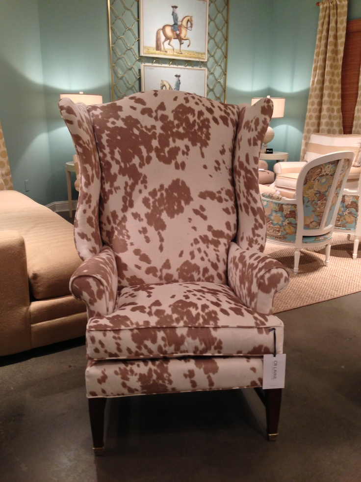 "Ooh-la-la! I would like to introduce you to ""Moo-la-la the savvy + modern wing chair that I fell for hard at CR Laine today. The frame is fabu but the fabric is Eco-chic. Faux, faux, faux is the way to go here with the ""vegan"" fabric that is completely animal friendly. On the outside looking in it seems like a hide but after closer inspection and Holly's blessing I learned that it was a perfect imposter. See for yourself- its totally PC at 310 N Hamilton Floor 2. #hpmkt #hpmarketnews #modernique @crlaine"
